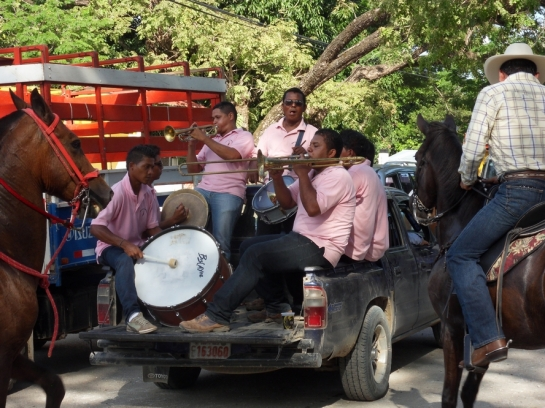 A small band serenaded from the back of a truck.